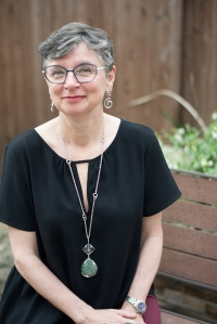 Poet Lisa Moore in her backyard in Austin, Texas